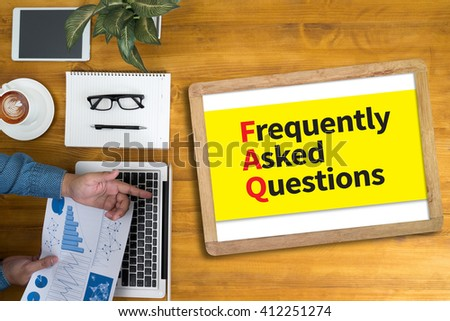 FAQ - Frequently Asked Questions Businessman working at office desk and using computer and objects, coffee, top view, - stock photo