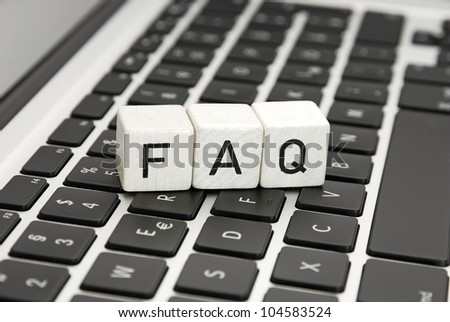 FAQ frequently asked questions sign symbol an a laptop keyboard - stock photo