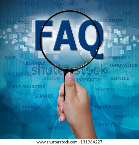 FAQ in Magnifying glass on blue background
