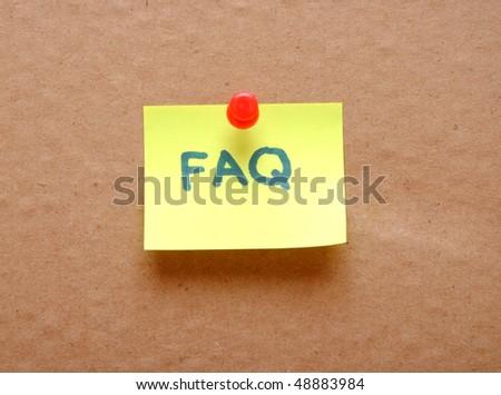 FAQ sticky note over cardboard background - stock photo