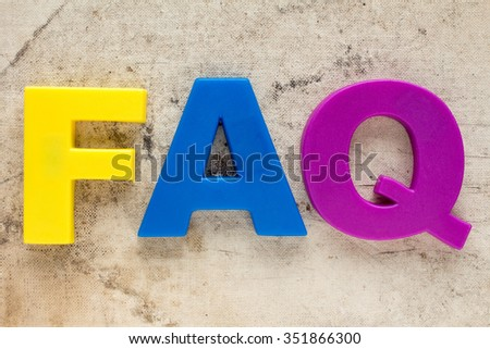 FAQ symbol on the old canvas background - stock photo