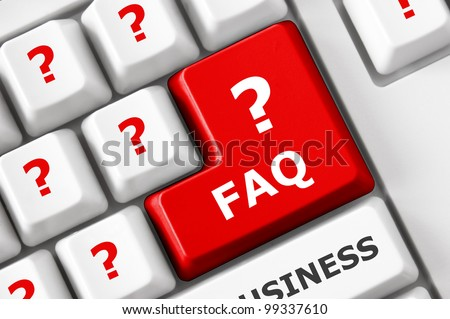 FAQ text and question symbols on the modern keyboard. Frequently asked question concept - stock photo