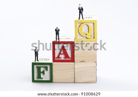 FAQ word and business man toy