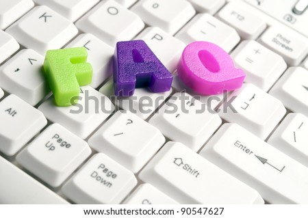 FAQ word made by colorful letters on keyboard