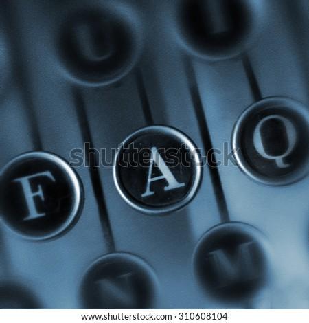 FAQ word on the Vintage Typewriter . Keyboard old typewriter with the word FAQ. Retro design element for web design. - stock photo
