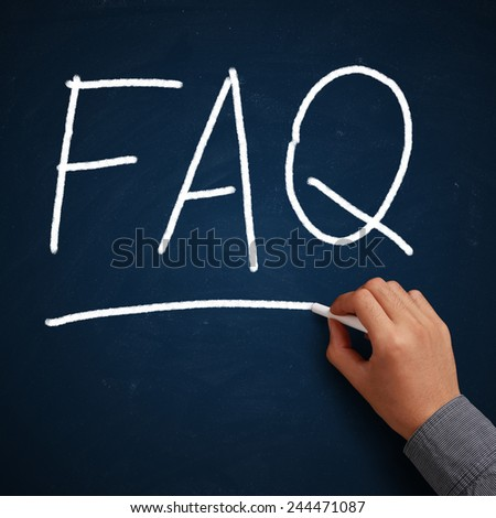 FAQ written on blue chalkboard with white chalk in hand.