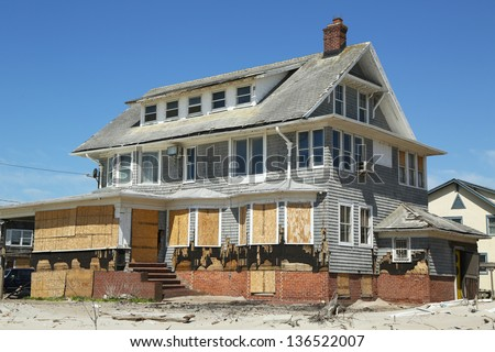 FAR ROCKAWAY, NY - APRIL 25: Destroyed beach house in devastated area six months after Hurricane Sandy on April 25, 2013 in Far Rockaway, NY