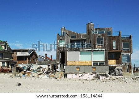 FAR ROCKAWAY, NY - APRIL 25: Destroyed beach house in devastated area six months after Hurricane Sandy on April 25, 2013 in Far Rockaway, NY  - stock photo