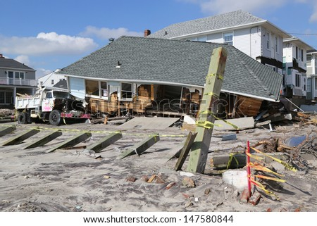 FAR ROCKAWAY, NY - FEBRUARY 28: Destroyed beach house four months after Hurricane Sandy on February 28, 2013 in Far Rockaway, NY  - stock photo