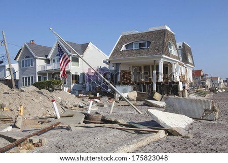 FAR ROCKAWAY, NY - NOVEMBER 11: Destroyed beach houses in the aftermath of Hurricane Sandy on November 11, 2012 in Far Rockaway, NY. Image taken 12 days after Superstorm Sandy hit New York - stock photo