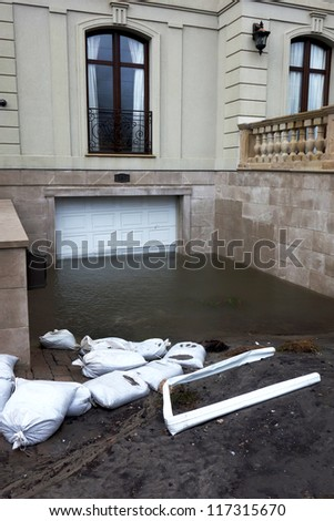 FAR ROCKAWAY, NY -OCTOBER 30: Flooded garage in the aftermath of Hurricane Sandy on October 30, 2012 in Far Rockaway, NY    					 - stock photo
