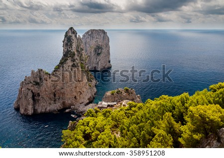 Faraglioni and sea with stormy sky at Capri - Italy - stock photo