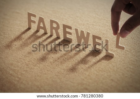 FAREWELL wood word on compressed or corkboard with human's finger at L letter.