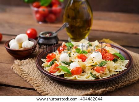 Farfalle Pasta - Caprese salad with tomato, mozzarella and basil - stock photo