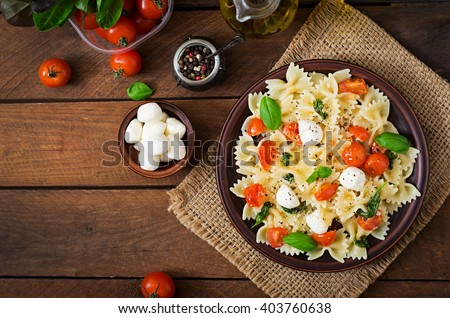Farfalle Pasta - Caprese salad with tomato, mozzarella and basil. Top view