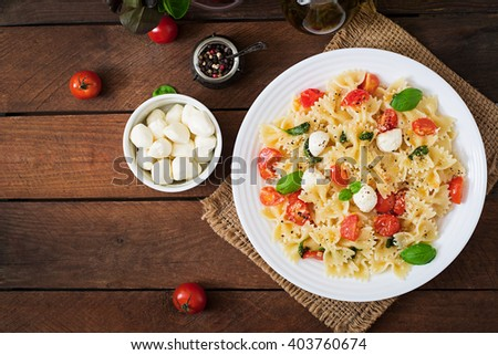 Farfalle Pasta - Caprese salad with tomato, mozzarella and basil. Top view - stock photo