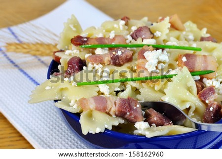 Farfalle pasta with bacon and cottage cheese - closeup. Shallow DOF. - stock photo