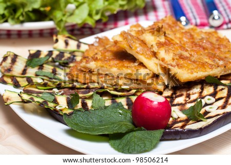 Farinata sliced with grilled vegetables - stock photo