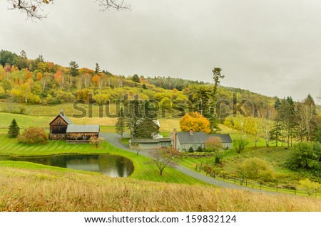 Farm and Cloudy Sky in Autumn - stock photo