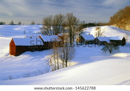 Farm at sunrise in winter snow, VT - stock photo