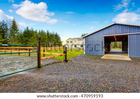 Farm Blue Barn Shed And Gravel Driveway. Northwes, USA