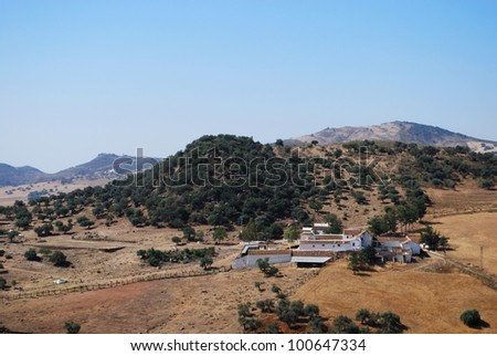 Farm (Cortijo) amongst wheat fields and mountains, Near Almogia, Costa del Sol, Malaga Province, Andalusia, Spain, Western Europe. - stock photo