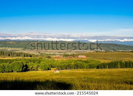 Farm country in the foothills of the rocky mountains, Alberta Canada - stock photo