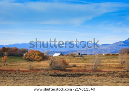 Farm countryside in autumn color in western Wyoming, USA. noise - stock photo