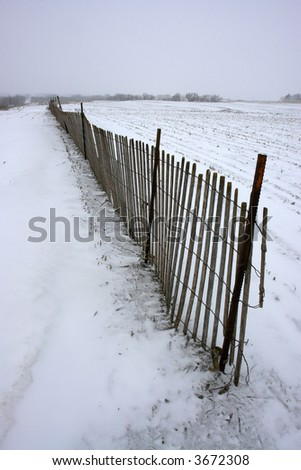 Farm fence in the snow