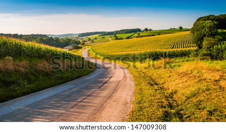 Farm fields along a country road in rural York County, Pennsylvania. - stock photo