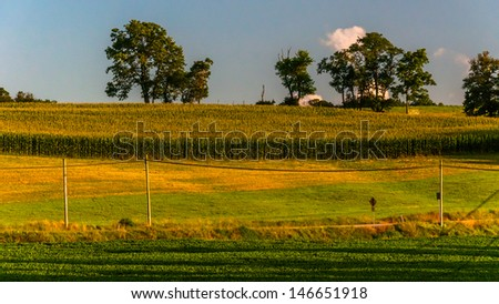 Farm fields along a country road in York County, Pennsylvania. - stock photo
