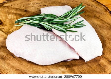 Farm Free Range  Chicken Breast on cutting board and straw - stock photo