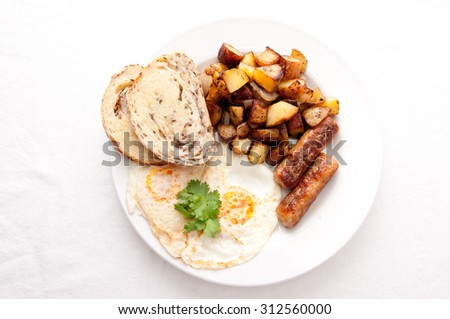 farm fresh eggs and sausage with hand cut hashbrowns and sourdough toast