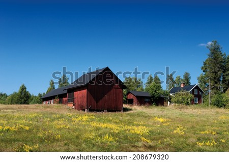 Farm in the country side of southern Sweden, Smaland, near the small town Vimmerby in summer - stock photo