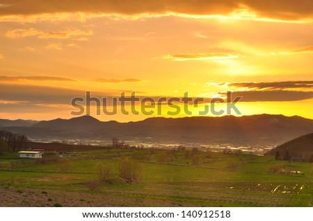 Farm Landscape with sunset - stock photo