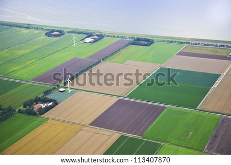 Farm landscape with windmill  from above, The Netherlands - stock photo