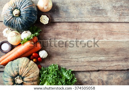 Farm market photo with different vegetables and greens - view from the top. Organic products and healthy lifestyle photography. Fresh food on the wooden background.  - stock photo
