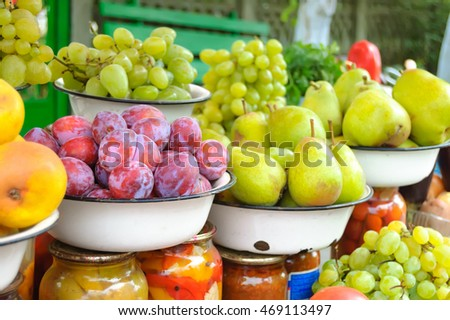 Farm market photo with different vegetables, fruits and homemade preserves - shallow depth of field.