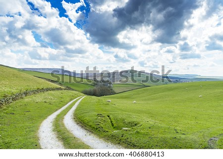 Farm Track leading to a farm in the Derbyshire Peak District National Park, near Buxton and Macclesfield, England, UK