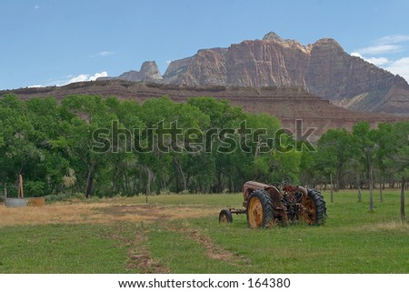 Farm Tractor and Mountains