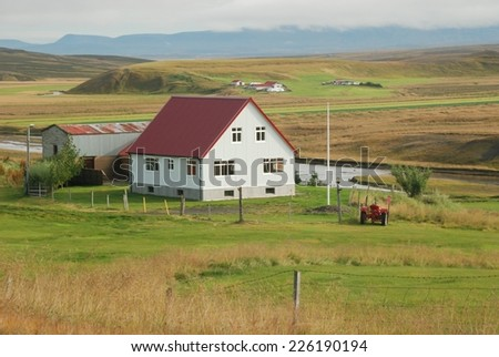 Farm with a red roof in Iceland