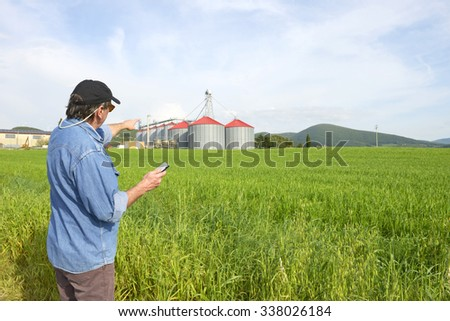 Farmer and silos - stock photo