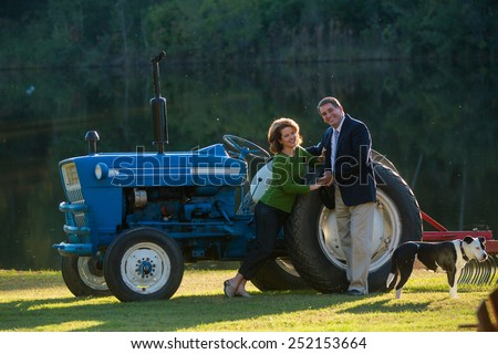 farmer business man and his wife - stock photo