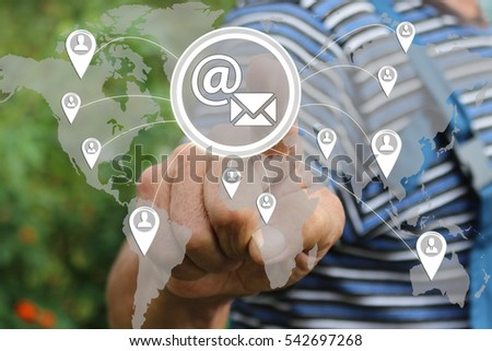 Farmer businessman  clicks on the email button on virtual screen with the social network. The concept of email marketing. Tanned hands, male hands of an elderly person.