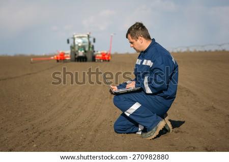 Farmer calculate - stock photo