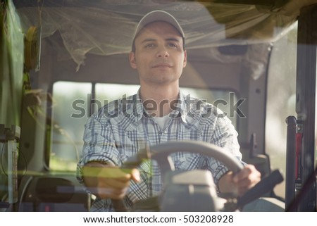Farmer driving a tractor in his field