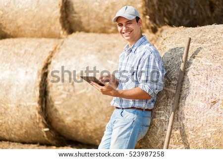 Farmer holding a tablet