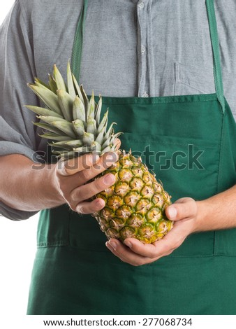 Farmer holding pineapple fruit isolated on white background - stock photo