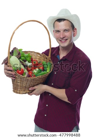 farmer in a red shirt holding a basket of vegetables