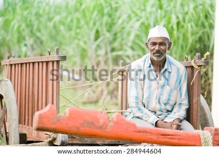 Farmer in empty bull cart, rural village, Salunkwadi, Ambajogai, Beed, Maharashtra, India. - stock photo